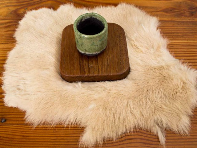 ceramic teacup or coffee cup on teak wood coaster on wood table